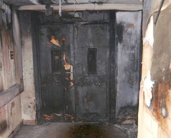 burned fire exit, no proper fire doors installed - Select Safety Services