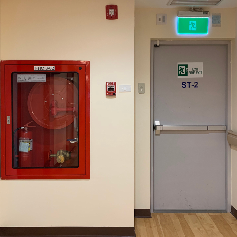 Fire extinguisher and fire exit - Fire safety at Select Safety Services